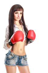 sexy young and fit female fighter posing in combat poses
