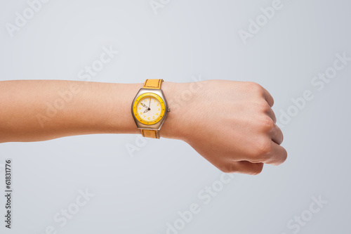 Hand with watch showing precise time - 61831776