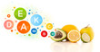 Healthy fruits with colorful vitamin symbols and icons