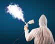 Painter with airbrush gun and white magical smoke