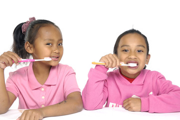 Couple Little girl brushing teeth with white toothbrush