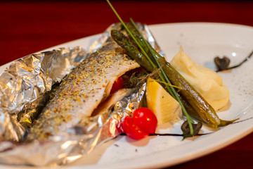 Image of baked fish with vegetables