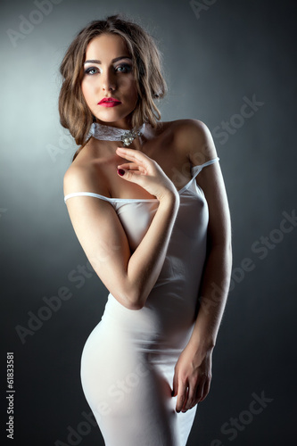 Portrait of sensual model in skin-tight negligee