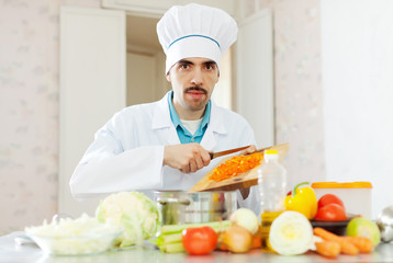 caucasian male cook with  vegetables