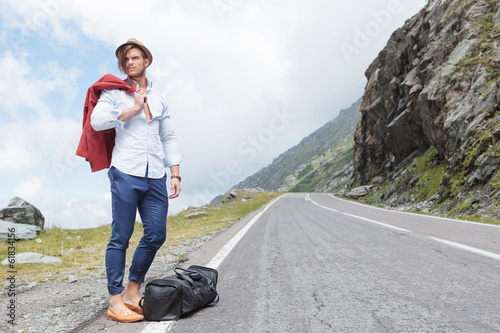 young fashion man posing on road side