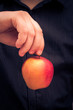 man holding red apple hand