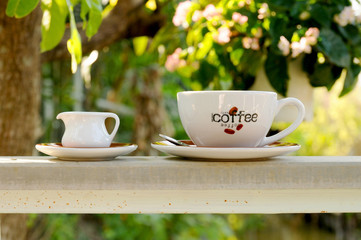 coffee on rail in garden