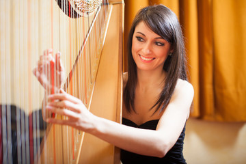 Woman playing an harp