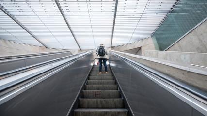 Tourist inside metro station on escalators. Lisbon, Portugal.