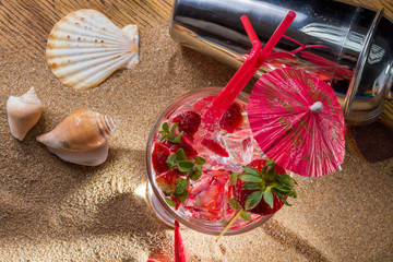 strawberry tropical cocktail with shaker and starfish