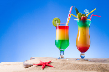 Fresh tropical cocktail on sunny beach