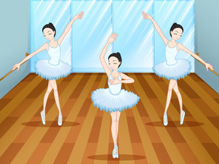 Three ballet dancers dancing inside the studio