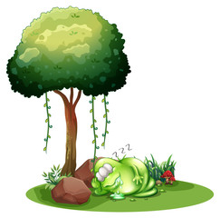 A fat green monster sleeping under the tree
