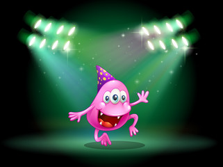 A monster dancing in the middle of the stage