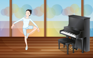 A ballet dancer inside the studio with a piano