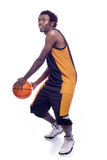 Basketball player dribbling, isolated in white background