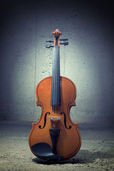 Violin on concrete wall