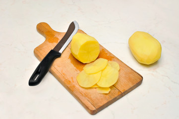 Sliced, peeled raw potatoes