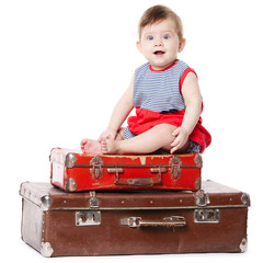 beautiful baby with suitcase isolated on white