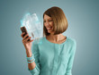 Pretty modern woman using her smartphone and virtual interface t