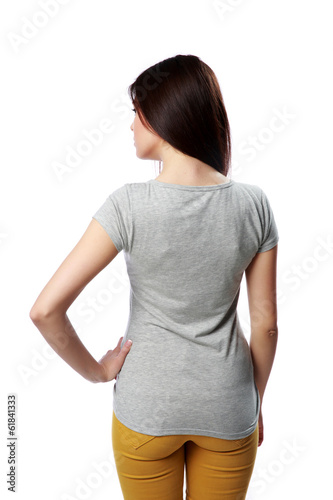 Backview portrait of a young woman standing