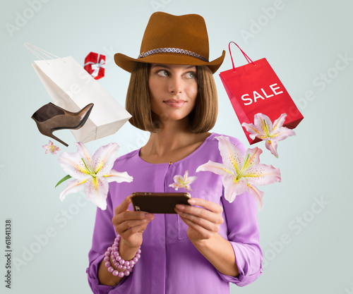 Woman shopping online using her smartphone