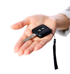 Closeup portrait of a female hand holding car keys