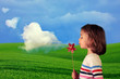 Clouds factory. Girl blowing heart shape clouds