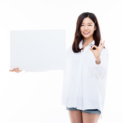 Asian woman showing banner.
