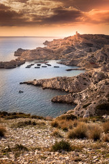 sunset on the Friulian islands, view of the castle and the sea,
