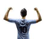 Uruguayan soccer player celebrates on white background