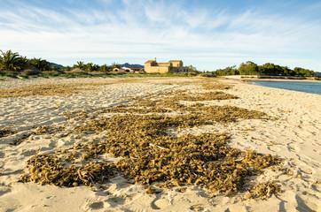 Sardegna, spiaggia di Nora e Chiesa di Sant'Efisio sullo sfondo