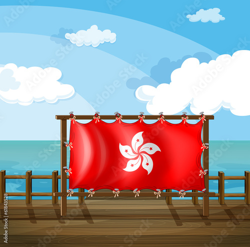 A wooden frame at the bridge with the flag of Hong Kong