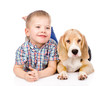 boy is lying near a puppy. isolated on white background