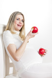 portrait of pregnant woman with red apples