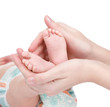 Newborn baby feet cupped into mothers hands. isolated on white