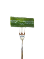 Large piece of cucumber pinned on a fork