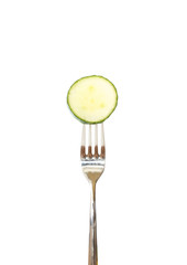 Slice of cucumber pinned on a fork