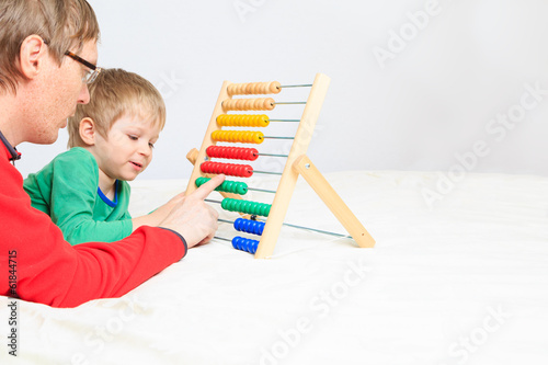 father and son playing with abacus
