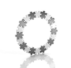 Black and white puzzle pieces in a circle isolated