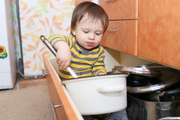 baby sitting in drawer on kitchen