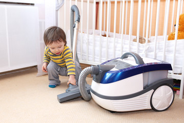baby with vacuum cleaner