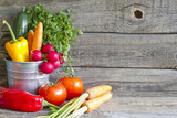 Fresh spring organic vegetables on wooden board