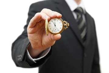 Businessman showing 5 minutes to twelve