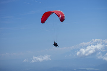 Paraglider over Austrian Alps with Krawanken Range on background