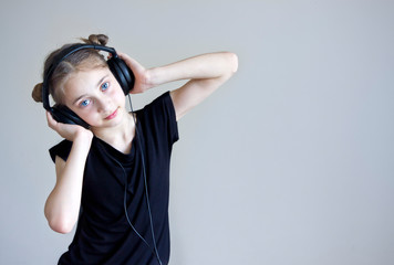 young girl listening to the music