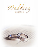 Two silver wedding rings and bride's shoes
