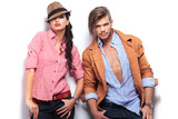 fashion young couple posing with hands in pockets