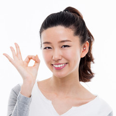 Cute woman with okay hand gesture