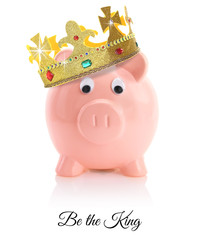 Piggy bank wearing a golden crown